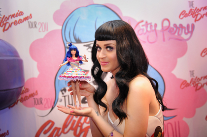 Katy shows us her 'Mini Me' (image via www.charitybuzz.com)