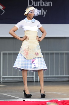 Deyi wearing Mmuso Moipolai's winning creation of this year's Vodacom Durban July Fashion Challenge