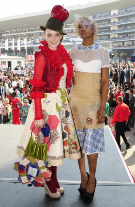Rebecca Brink wearing Teresa Joubert's second place creation, and Deyi wearing Mmuso Moipolai's winning creation of Vodacom Durban July Fashion Challenge